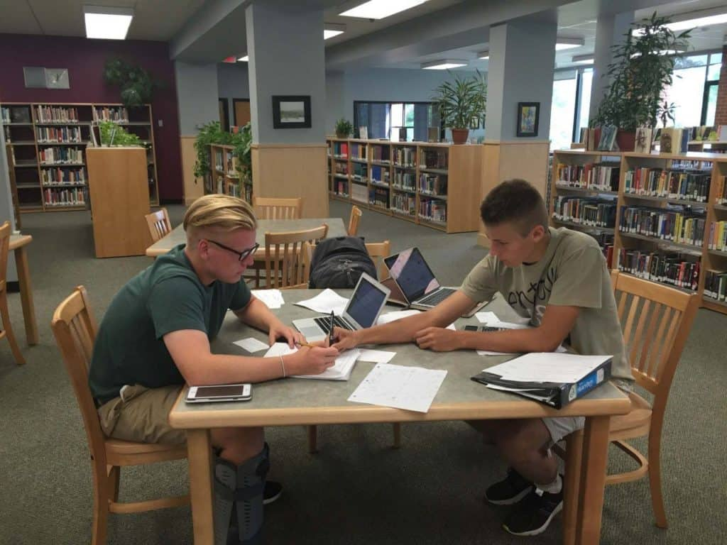 students working in a library together