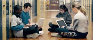 Students In Hallway With Laptops