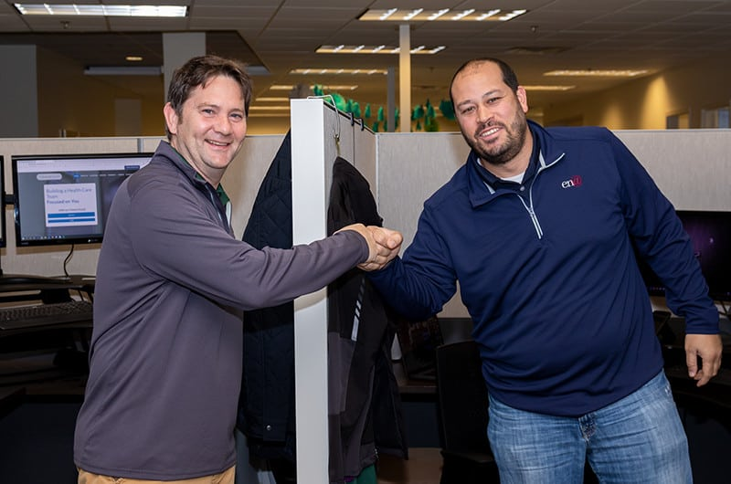 Account manager and client shaking hands